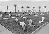 usa. arizona. sun city outdoor group fitness early in the morning in the retirement sun city. ages range from 60 to a 94 year old who had run a 50secs hundred meters in the senior olympics. the sense of fun and community was very infectious. 1980 by david hurn