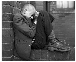 youth on wall, jarrow, tyneside, uk by chris killip