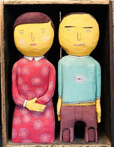 box with two sculptures by osgemeos