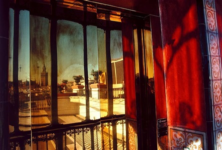 spain. andalucia. sevilla. balcony of a hotel. 1993. by gueorgui pinkhassov