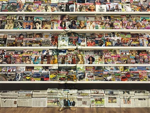 hiding in the city - swiss magazine rack by liu bolin