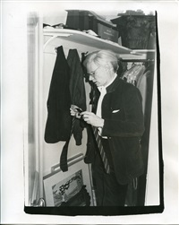 andy warhol in the front hall closet of the east 66th street house, getting ready to go out by bob colacello