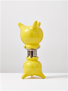 yellow standing object with platin by michael geertsen
