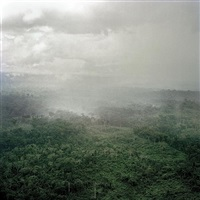 liberia. fish town. june 2005. rain clouds gather over the forest near to fish town. by tim hetherington