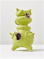 lime green standing object with platin by michael geertsen