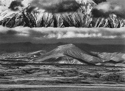 tolbachik volcanoe. in the background, the huge base of kamen volcano. kamchatka. russia. by sebastião salgado