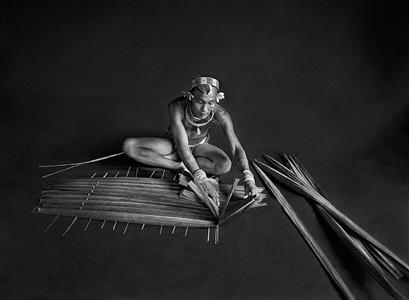 teureum, sikeirei (shaman), leader of the mentawai clan, preparing a filter for sago. siberut island. west sumatra. indonesia. by sebastião salgado