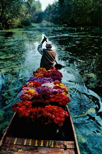 flower seller, dal lake, srinagar, kashmir by steve mccurry