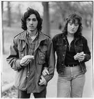 a young man and his girlfriend with hot dogs in the park, n.y.c. by diane arbus