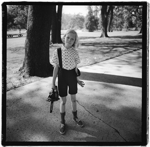 diane arbus (allegedly). child with toy chainsaw in griffith park, los angeles by hugh brown