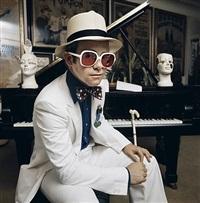 elton john sitting at piano by terry o'neill