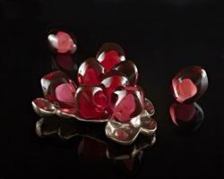 pomegranate seeds, nestled on bronze ii by catherine vamvakas lay