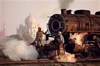 taj and train, agra, india, 1983 by steve mccurry