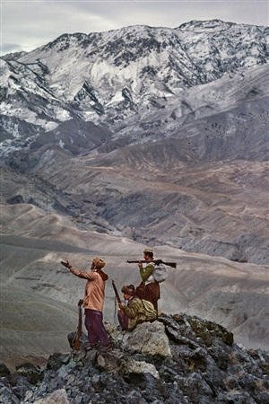 mujahideen stand atop a mountain in the hindu kush, 1984 by steve mccurry