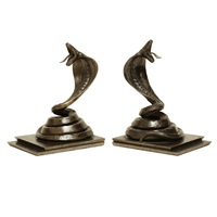 pair of wrought iron cobra bookends by edgar-william brandt
