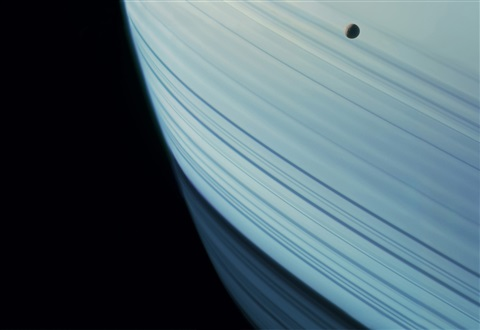 mimas above saturn's rings and shadows, cassini, november 7, 2004 by michael benson
