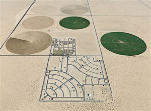 pivot irrigation/suburb, south of yuma by edward burtynsky
