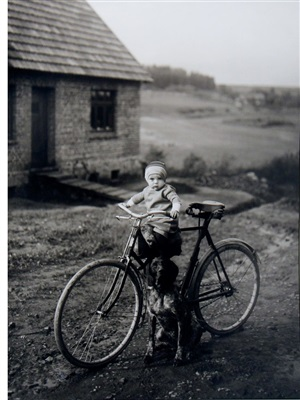 farm child on bicycle by august sander