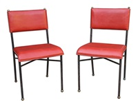 pair of red leather chairs by jacques adnet