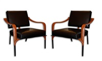 exquisite pair of lounge chairs by jacques adnet