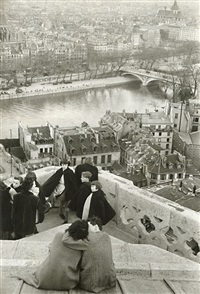 schoolchildren looking from the top of notre-dame cathedral at the seine river, paris by henri cartier-bresson