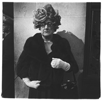woman with white gloves and a fancy hat by diane arbus