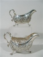pair of antique irish george ii sterling silver sauce boats