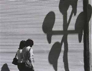 two women, a large blind, and shadows by manuel alvarez bravo