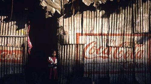 girl in doorway mumbai by joe mcnally