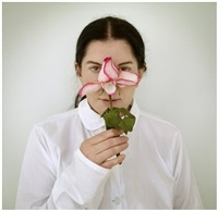 artist portrait with a rose by marina abramović