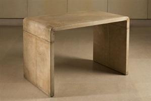 table en u inversé entièrement gainée de parchemin by jean-michel frank