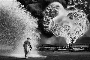 oil wells firefighter. greater burhan, kuwait by sebastião salgado