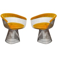 pair of small lounge chairs in a bronze finish by warren platner by warren platner