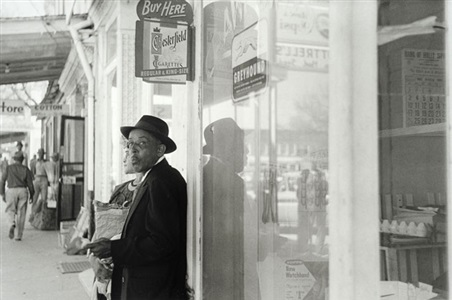 untitled man and chesterfield sign by william eggleston