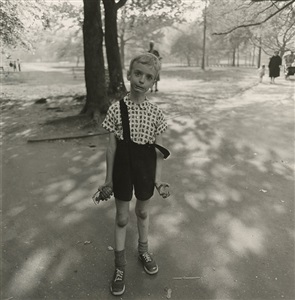 child with a toy hand grenade in central park nyc by diane arbus