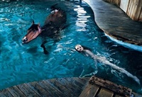 girl with horse in pool by steven klein
