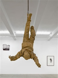 figure hanging from one foot by juan muñoz
