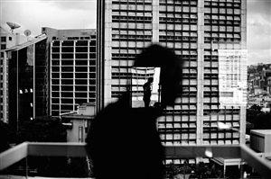 venezuela. caracas. 2006. reflection in window in altamira. by christopher anderson