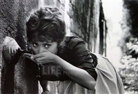 actress sophia loren drinking water from a spigot, italy by alfred eisenstaedt