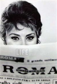 actress sophia loren peering over the top of a roma newspaper, rome, italy by alfred eisenstaedt