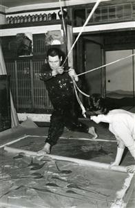 kazuo shiraga painting in his studio with the assistance of fujiko shiraga by kazuo shiraga and fujiko shiraga