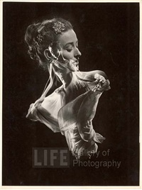 double exposure, model with swirling evening dress over close up of her head with faux jewel hair by gjon mili
