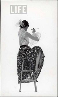 model dorian leigh wearing white organdy shirt with full print skirt by ceil chapman by gjon mili