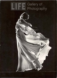 model with billowing light colored sheer nightgown and peignoir (face not seen) by gjon mili