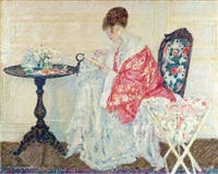girl embroidering by frederick carl frieseke