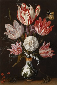 a still life of tulips and other flowers in a ceramic vase by balthasar van der ast
