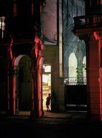 woman in doorway, havana by michael eastman