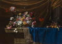 a still life of a basket of flowers and a mound of fruit on a sculpted stone table by jean-michel picart