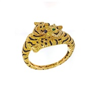 rare bracelet decorated with a gem set couple of laying tigers by cartier