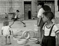 italy.sicily. palermo. soccer in the street. 1950. by herbert list
